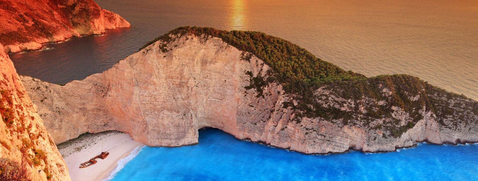 Sunset over Smugglers Cove on Zakynthos island