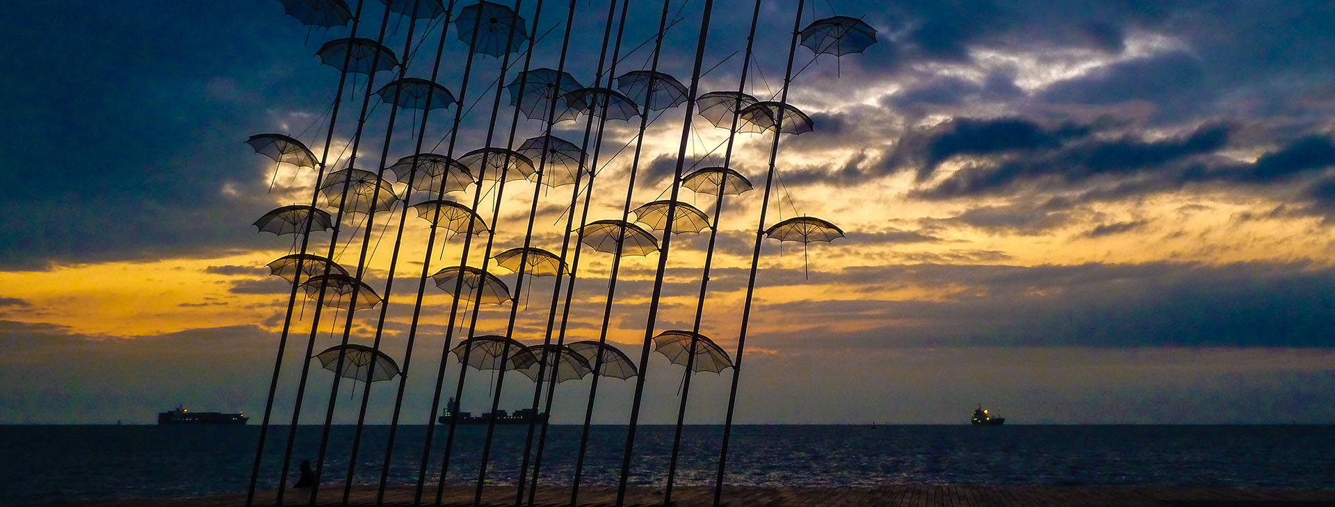 """""""Umbrellas"""" modern art statue during sunset at the seafront of Thessaloniki City"""